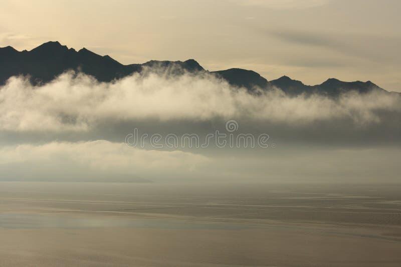 Mist above lake Wakatipu in New Zealand royalty free stock photo
