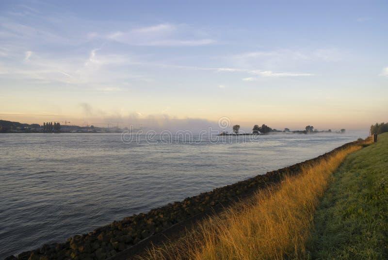 Mist above the river Merwede. Near Boven-Hardinxveld in the Dutch region Alblasserwaard royalty free stock images