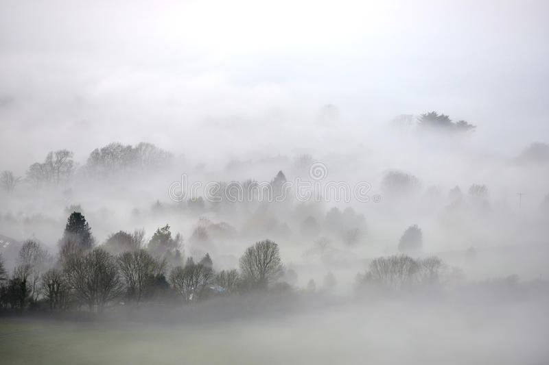 Mist. Countryside shrouded in thick fog and mist stock images