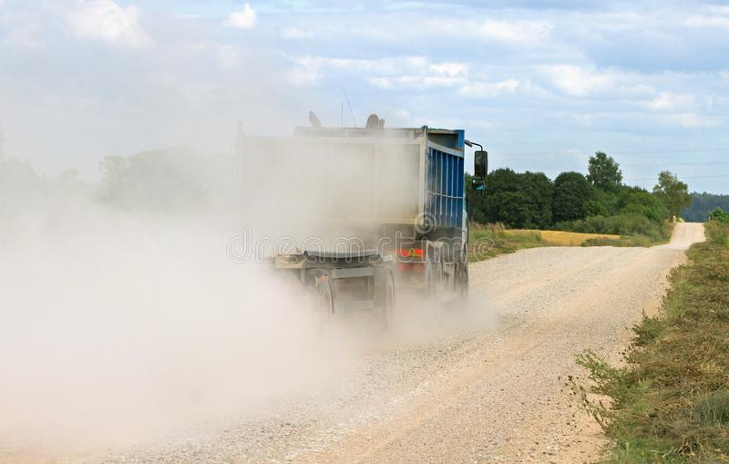 Mist of dust on the country road stock photos