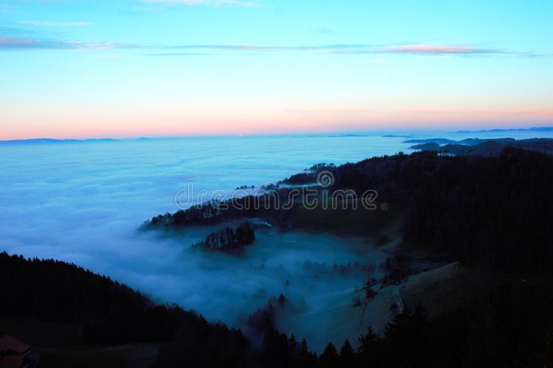 Mist between the hills. Mist crawling up the hills royalty free stock photography