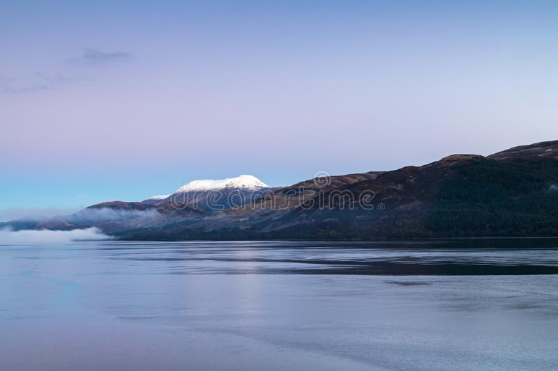 Ben Nevis. Mist on Loch Linnhe with a snowcapped Ben Nevis in the background royalty free stock image