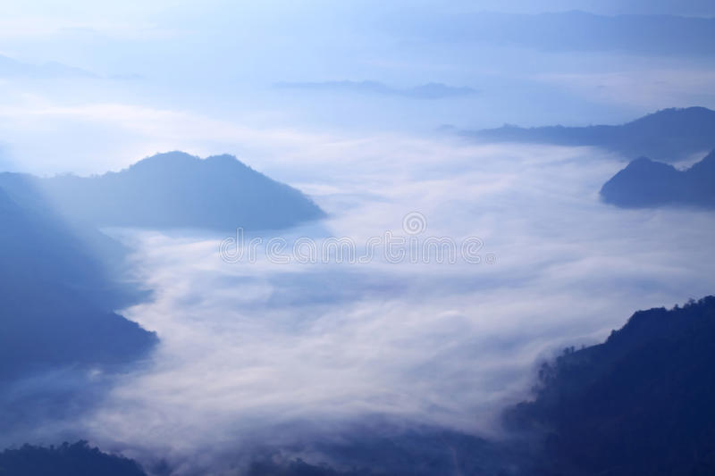 Mist on mountain. White mist on moutain in morning with cloudy royalty free stock image