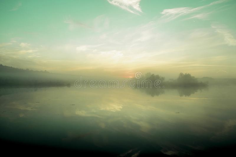 Mist over lake.The Urals landscape in the morning. The fog of dawn stock image