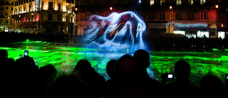 Mist projection - Fete des Lumieres 2010. Un Air Du Large, by Marie-Jeanne Gauthe. Installation as part of Fete des Lumieres 2010, in Lyon, France royalty free stock images