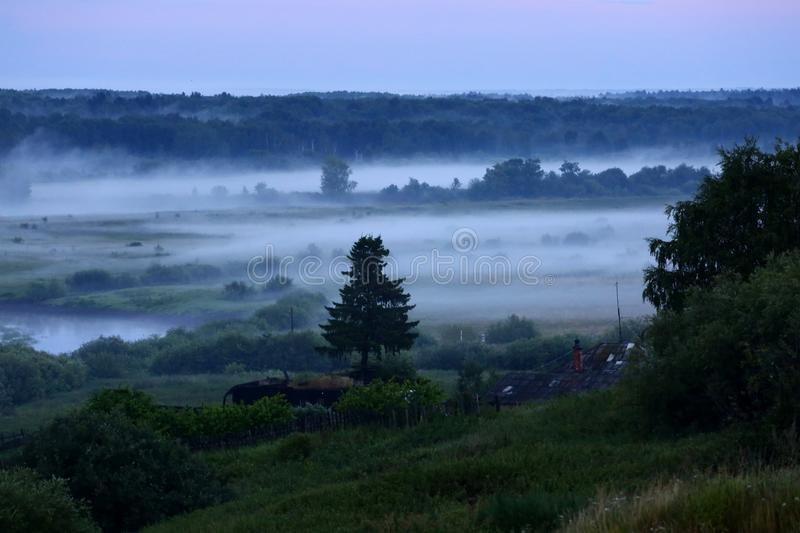Mist after the rain. Misty landscape with river Nitsa royalty free stock photo