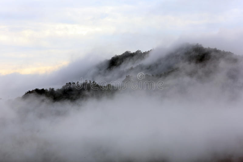 The mist rising over the mountains stock image