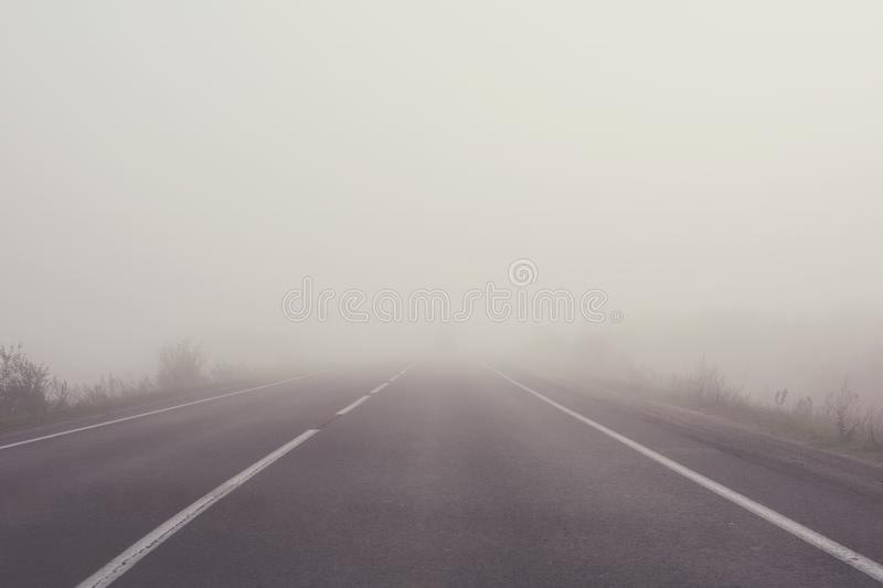 Mist on the road. Soft focus. Toned stock images