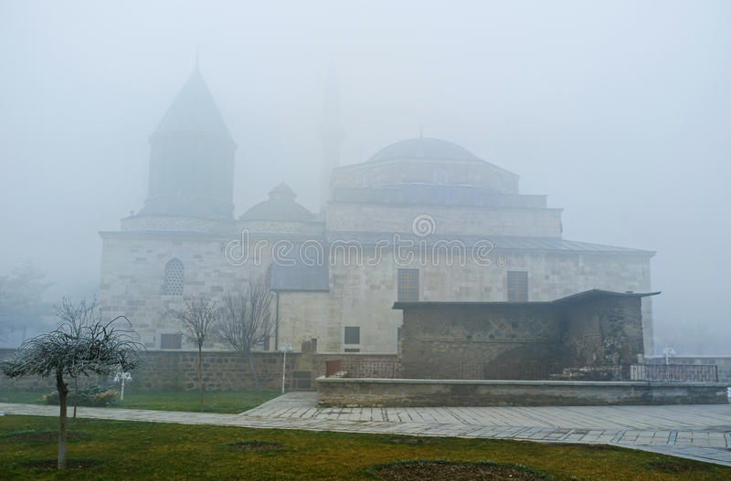 Through the mist. The silhouette of Mevlana Museum through the hard winter mist, Konya, Turkey royalty free stock photo