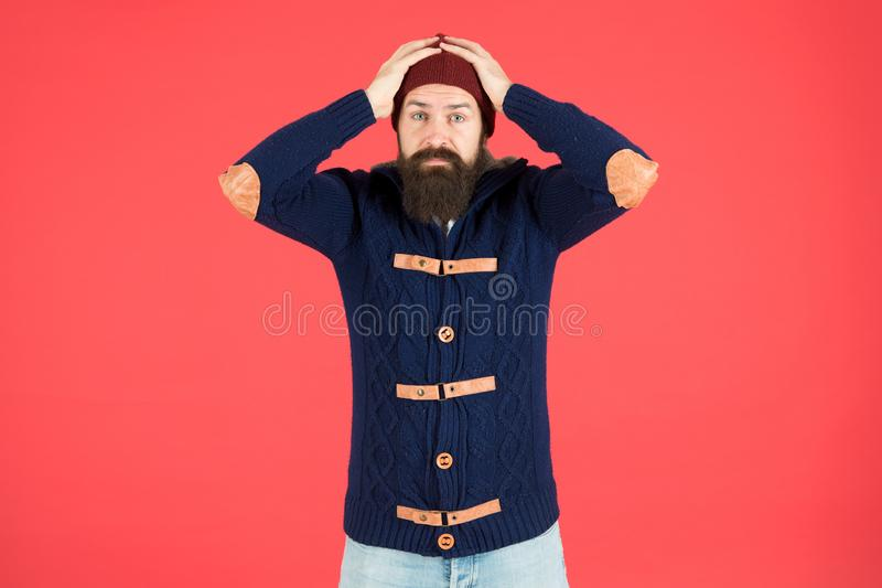 Mistake. Emotional expression. Casual clothes for winter season. Hipster with long beard. Hipster lifestyle. Stylish royalty free stock image