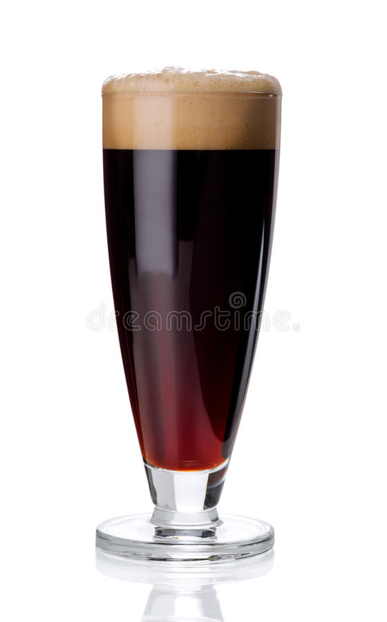 Misted glass of red beer on white stock image