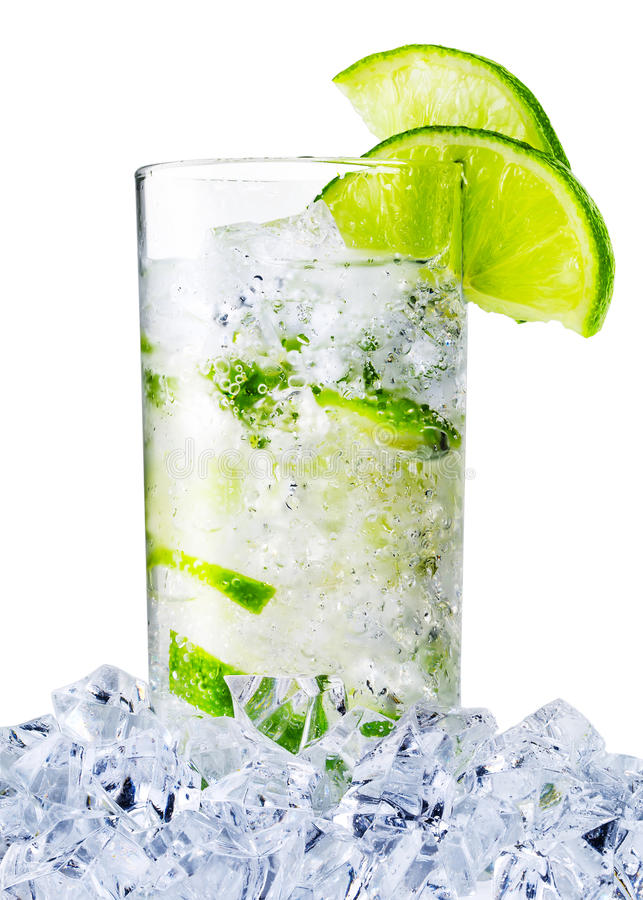 Misted glass of the water with lime and ice stock images