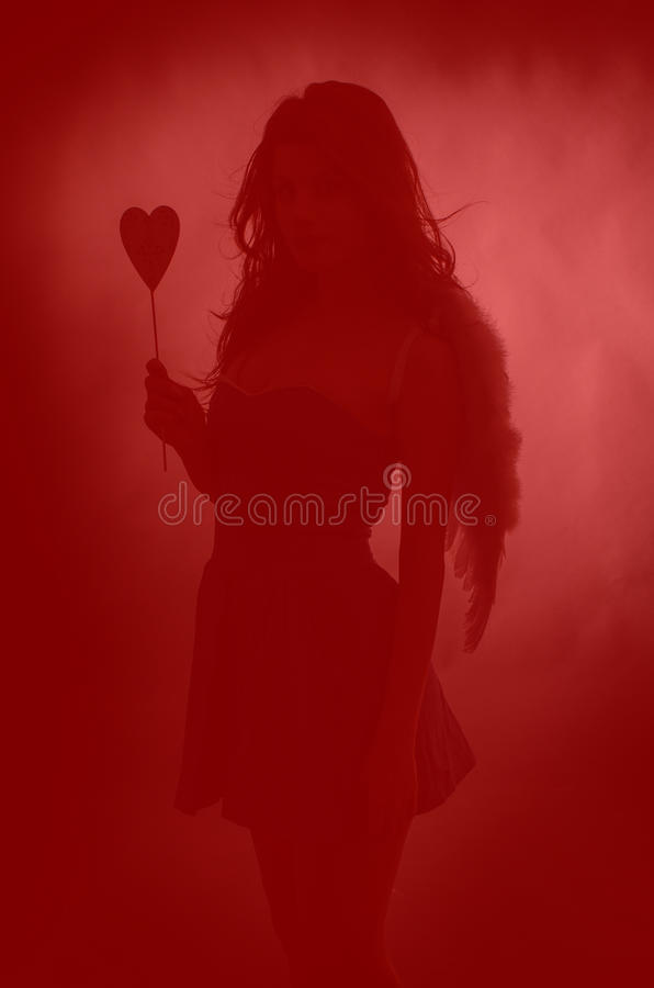Misterious Cupid stock photo