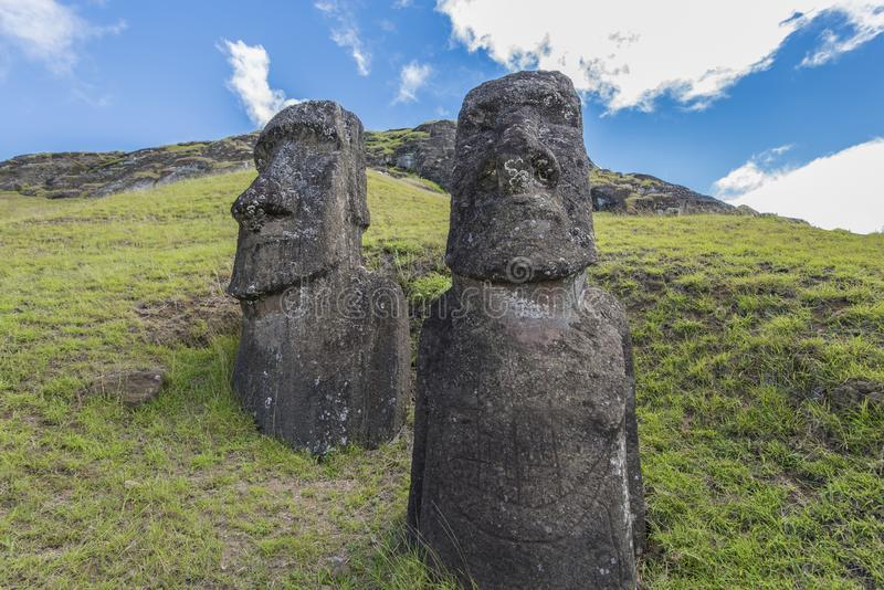 Misterious witnesses of a lost past. Path on the hill of the moais of the Rano Raraku volcano where all the moai were sculpted royalty free stock images