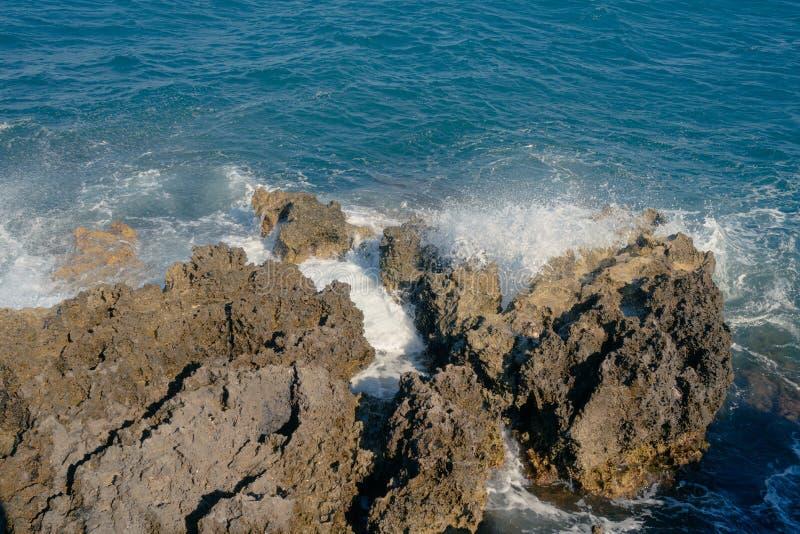 Mistral makes waves that splashing on the rocks royalty free stock photos