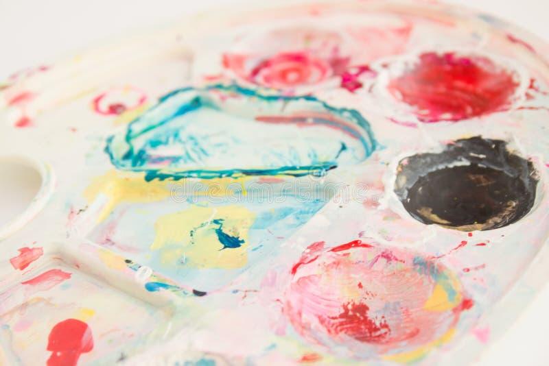 Misturar tintas, fechar Fundo colorido abstrato, papel de parede com paleta de artista imagem de stock royalty free