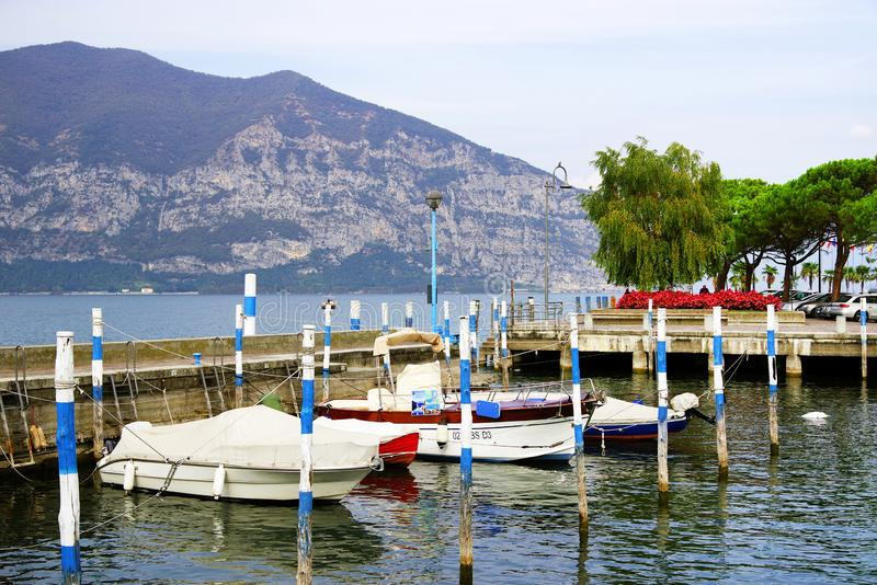Misty autumn morning light over Porto Gabriele Rosa on Iseo town. Iseo harbour. Lago d`Iseo or Sebino is the fourth largest lake in Lombardy, Italy, fed by the royalty free stock images