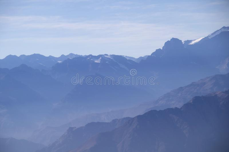 Misty blue Andean mountain landscape background royalty free stock photos