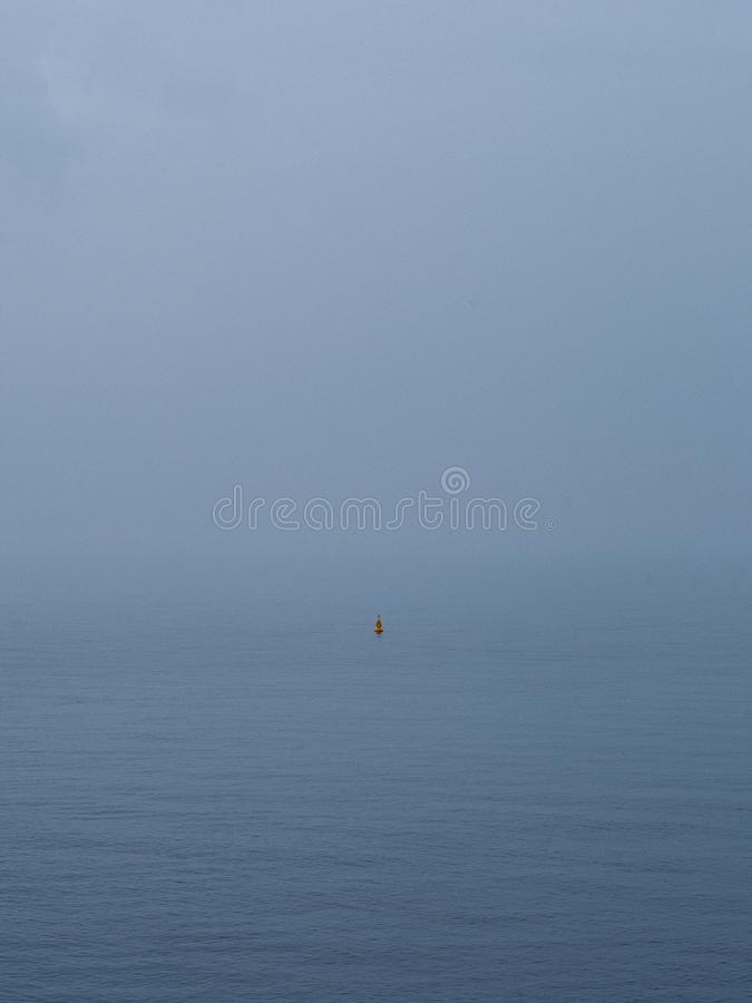 Misty bouy in open waters royalty free stock images