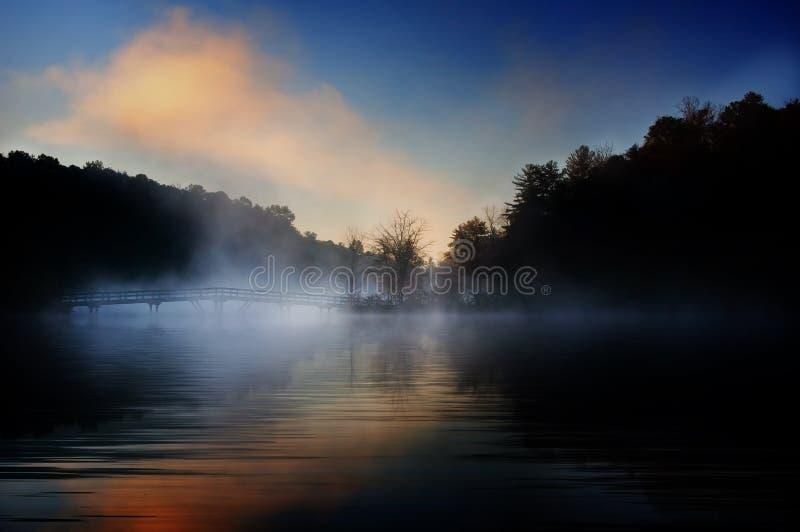 Misty bridge sunrise royalty free stock photos