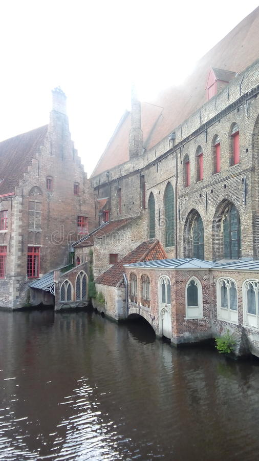 Misty canals of Bruges, Belgium royalty free stock image