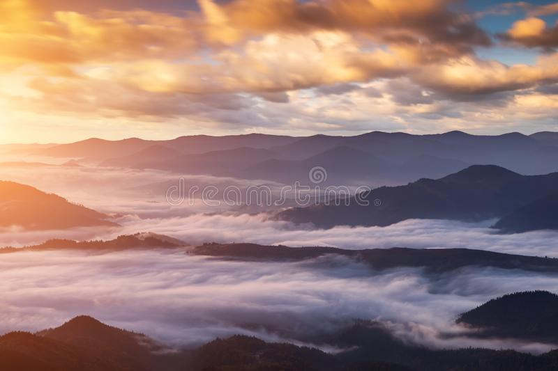 Misty dawn in the mountains. Beautiful landscape royalty free stock photos