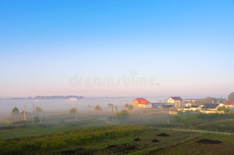 Misty dawn over the city, morning mist over the houses stock photo