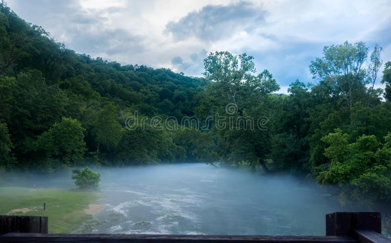 Misty fog Mouth of the Big springs Branch in Missouri. Headwaters of the Big Spring, Big springs Missouri stock image