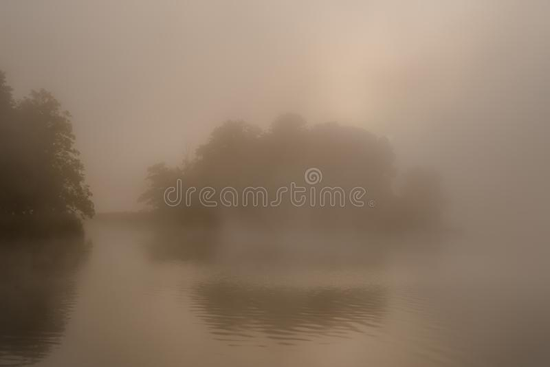 Misty foggy lake royalty free stock photo