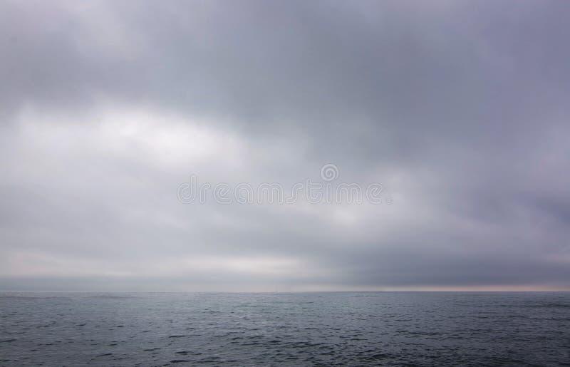 Misty foggy ocean landscape. In Mallorca, Spain in March stock photo