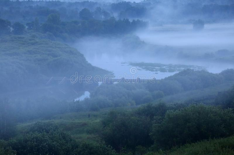Mist after the rain. Misty landscape with river Nitsa royalty free stock photos