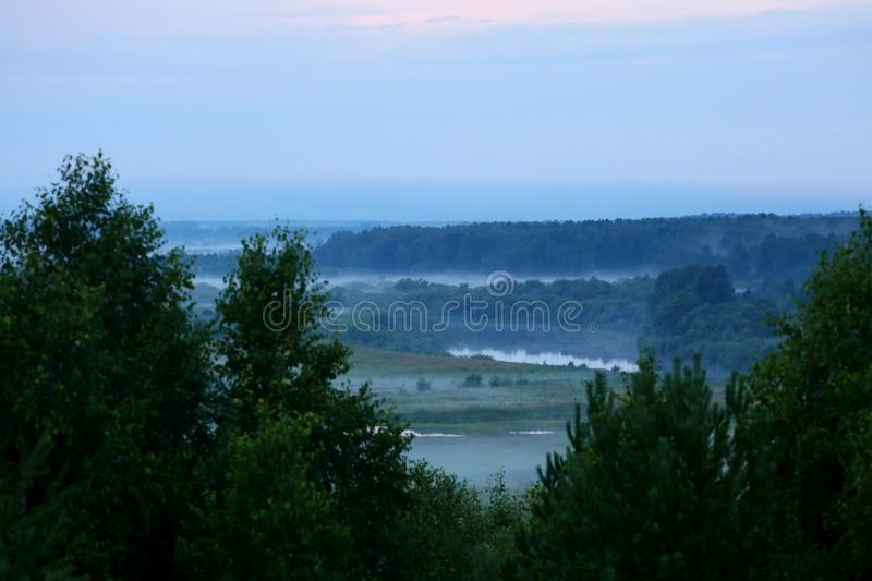 Mist after the rain. Misty landscape with river Nitsa royalty free stock image