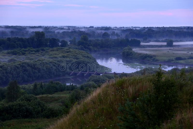 Mist after the rain. Misty landscape with river Nitsa stock images