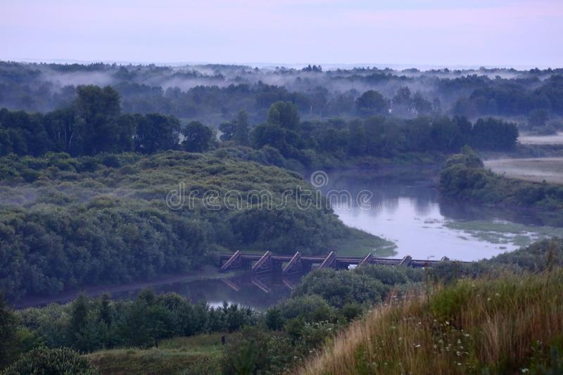 Mist after the rain. Misty landscape with river Nitsa royalty free stock photography