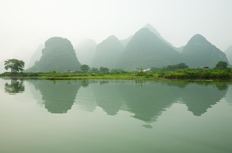 Misty Li river. With beautiful reflection, Guilin, Guangxi Region, China royalty free stock photos