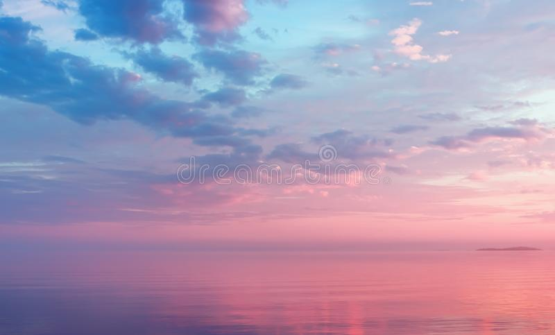 Misty Lilac Seascape With Pink Clouds stock photography