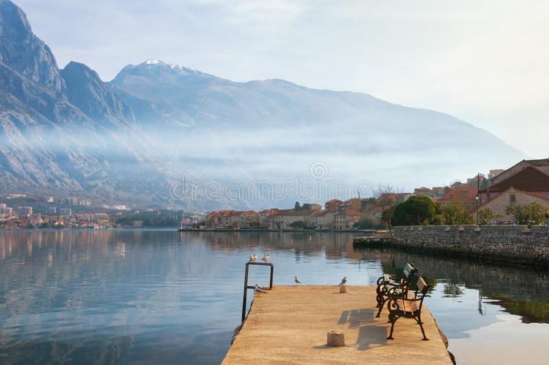 Misty Mediterranean landscape. Montenegro, view of Bay of Kotor and Prcanj town in winter stock photos