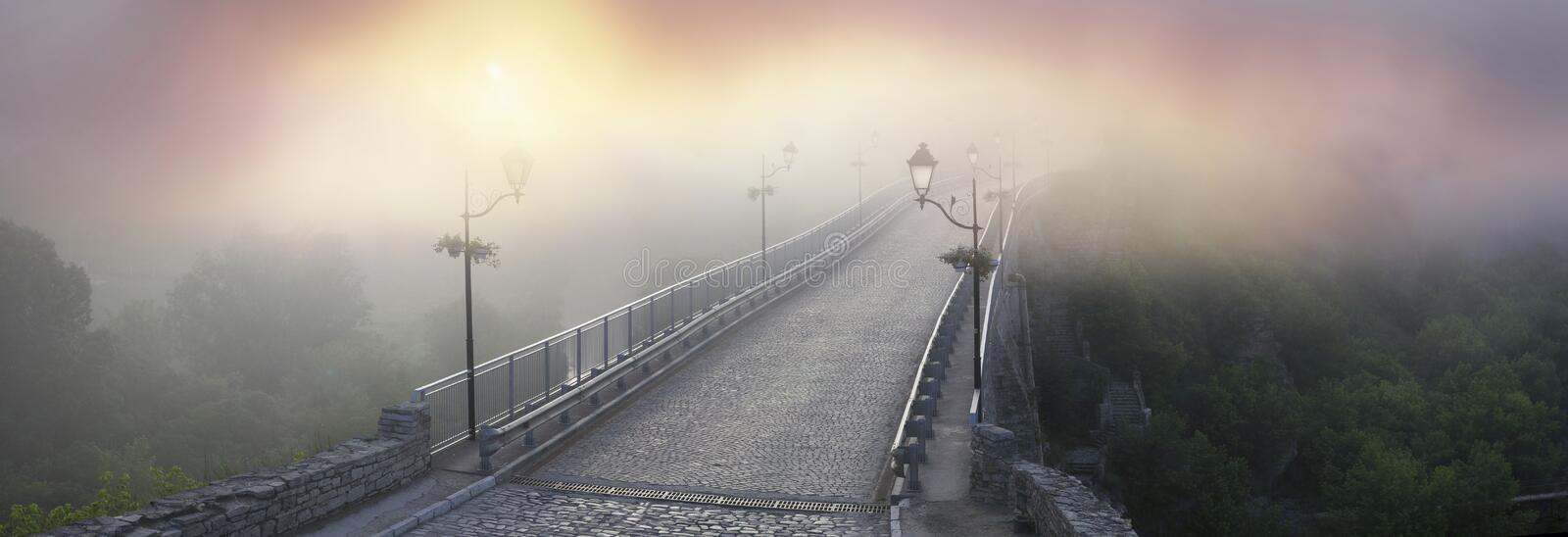 Misty morning bridge. Over the river below the castle in Kamyanets-Podilsky on the background of the legends of Ukrainian History royalty free stock image