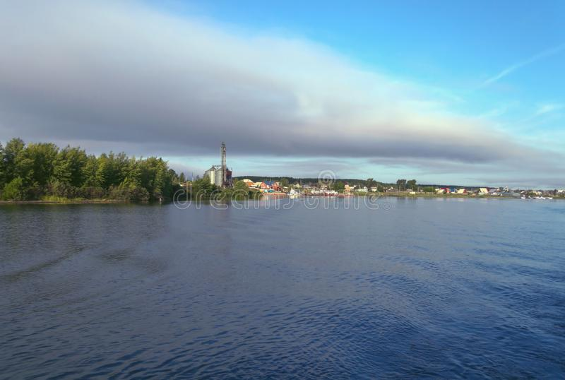 Misty morning clouds over river bank at countryside. View from river stock photo