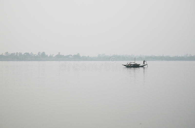 Misty morning on the holiest of rivers in India. Ganges delta in Sundarbans, India. Misty morning on the holiest of rivers in India. Ganges delta in Sundarbans royalty free stock photography