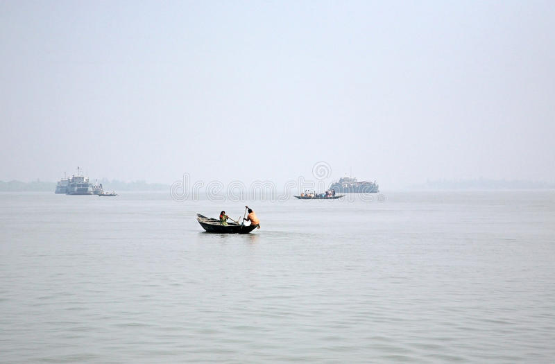 Misty morning on the holiest of rivers in India. Ganges delta in Sundarbans, India. Misty morning on the holiest of rivers in India. Ganges delta in Sundarbans stock photo