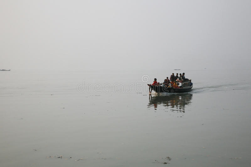 Misty morning on the holiest of rivers in India. Ganges delta in Sundarbans, India. Misty morning on the holiest of rivers in India. Ganges delta in Sundarbans stock photography