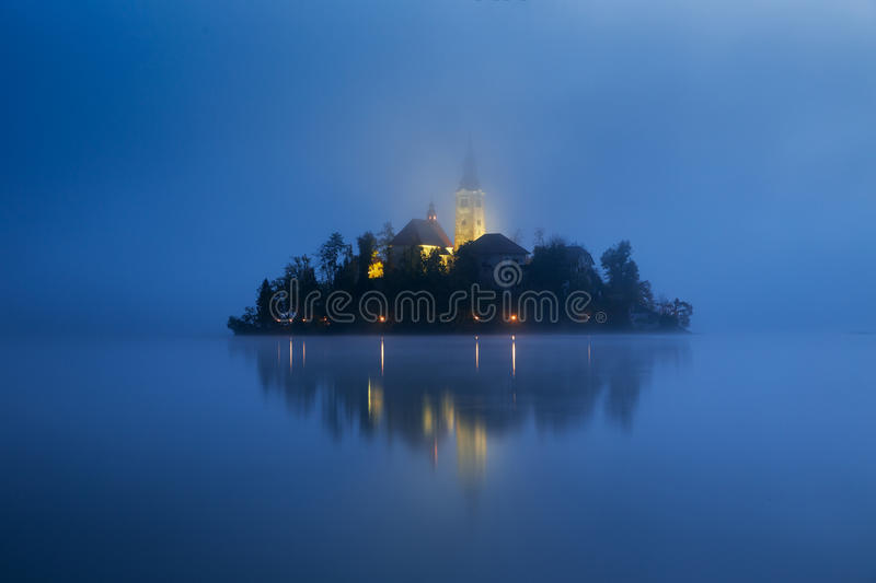 Misty morning in lake Bled stock photography