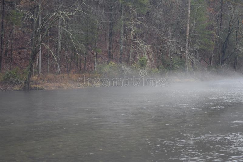 Misty morning over rippling waters. The Tellico River in Tennessee with an early morning fog royalty free stock photo