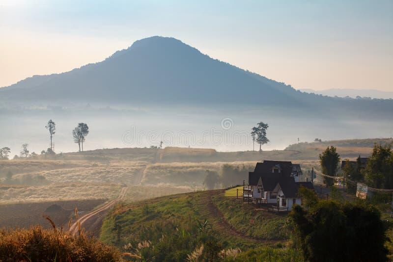 Misty morning sunrise and house in Khao Takhian Ngo View Point a. T Khao-kho Phetchabun,Thailand royalty free stock image