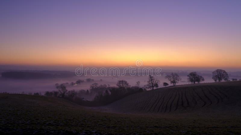 Misty morning sunrise over the Hambledon valley, Hampshire, UK stock images