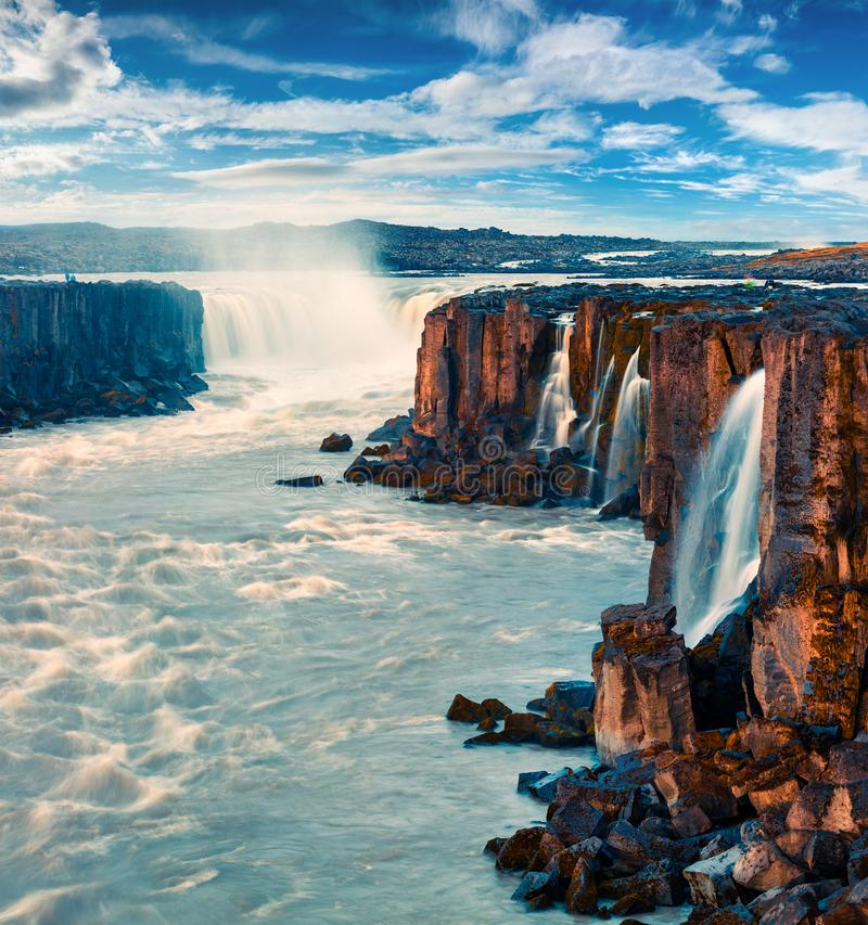 Misty morning view of Selfoss Waterfall. Summer outdoor scene in Jokulsargljufur National Park, Iceland, Europe. Beauty of nature concept background stock image