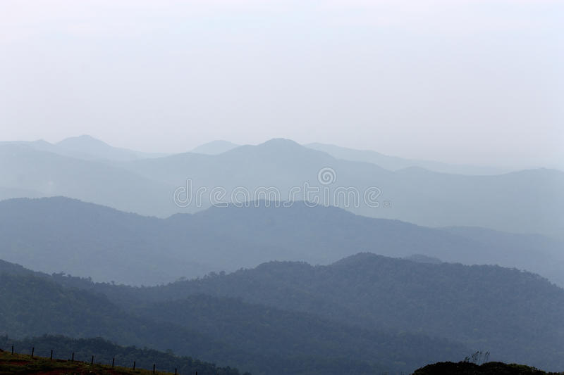Misty mountains. Fog or mist covered mountain series of Western Ghats of India. Photo taken at tourist destination tala cauvery of Coorg in early morning