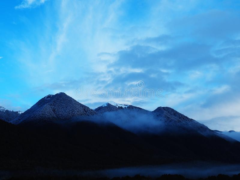 Misty Mountains in the Morning Fog of New Zealand royalty free stock photos