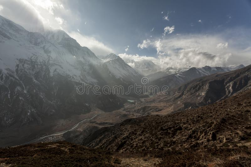 Misty mountains. Morning in Himalayas. Marsyangdi river valley, Nepal, Annapurna conservation area stock photography
